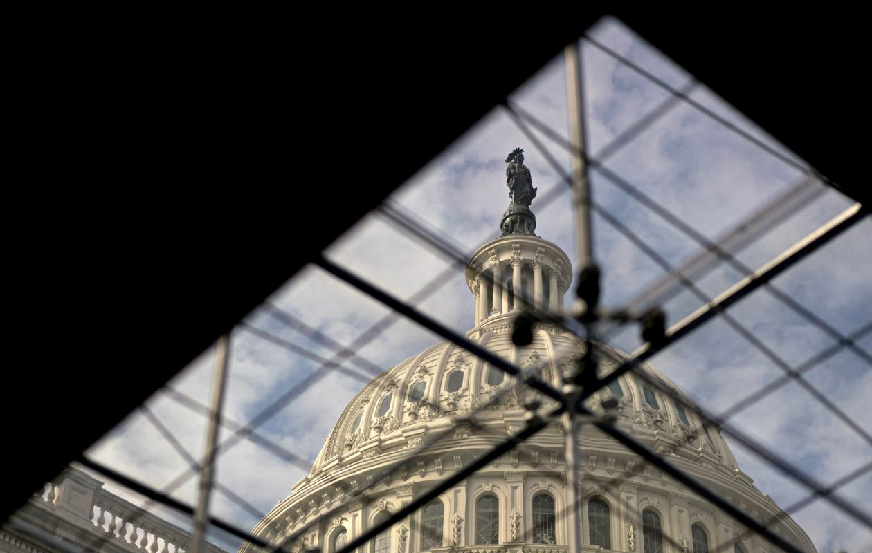 The Capitol is seen through the glass of a Capitol Visitor Center fountain. (Andrew Harrer/Bloomberg photo)