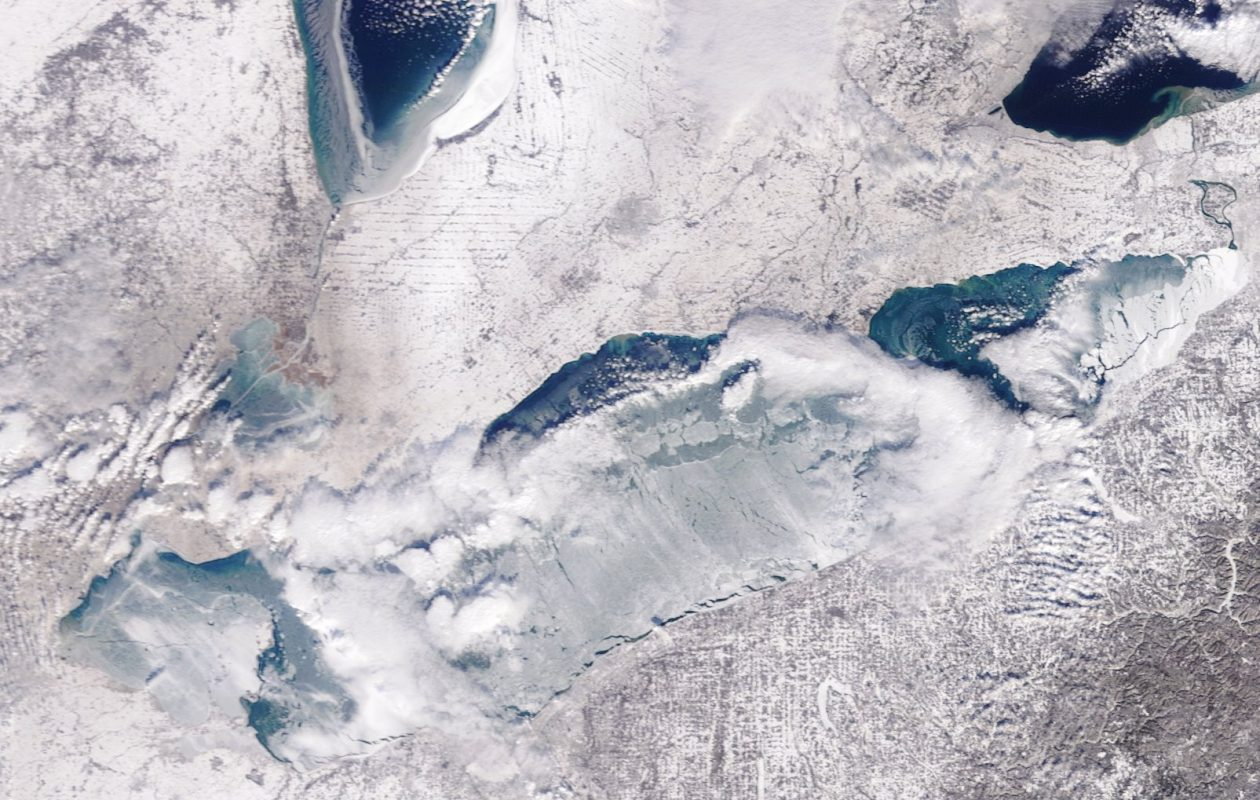 Much of Lake Erie is frozen, but there's still a pretty big pool of open water between Dunkirk and Long Point, Ont. that could serve to stir up a little bit of lake-effect snow overnight Tuesday, according to the National Weather Service. (NASA)