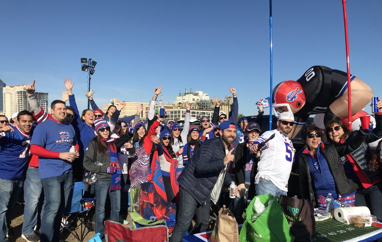 Bills fans warm up in the Jacksonville parking lot. (James P. McCoy/Buffalo News)