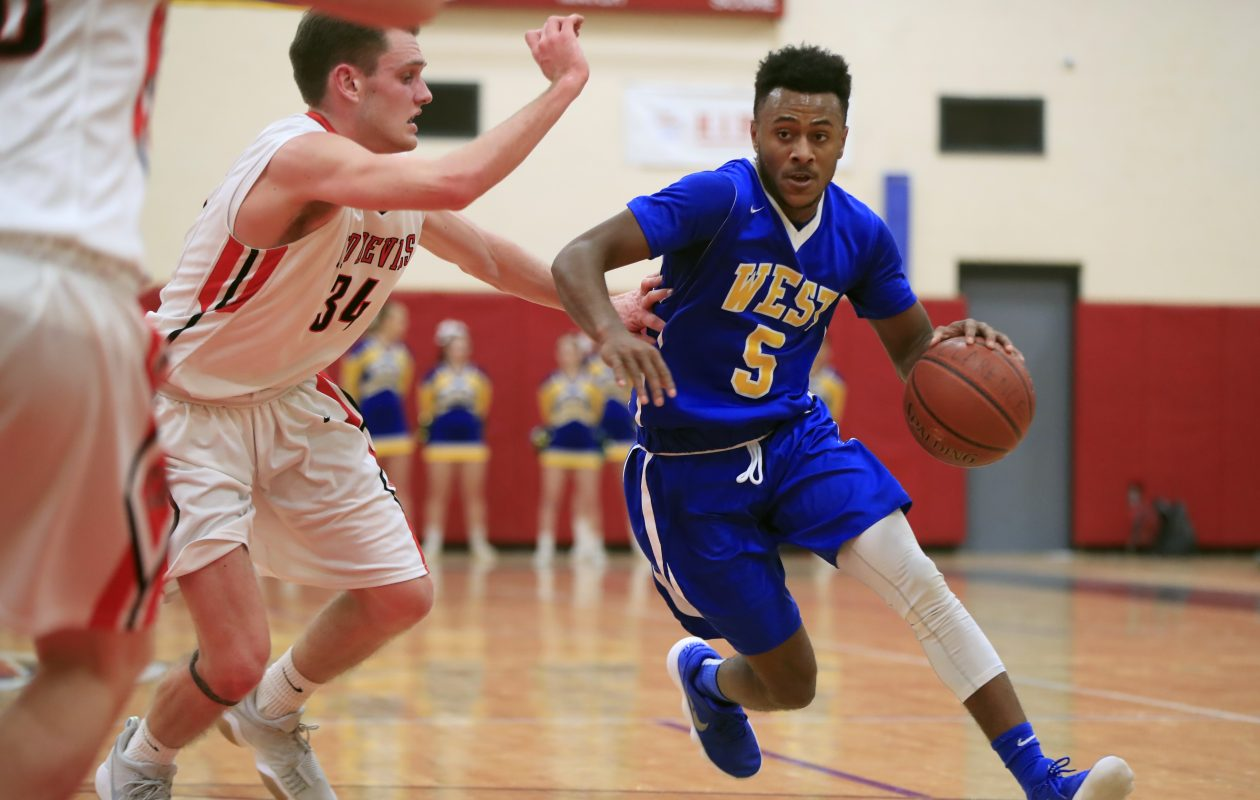 West Seneca West guard Juston Johnson on the dribble. (Harry Scull Jr./Buffalo News)