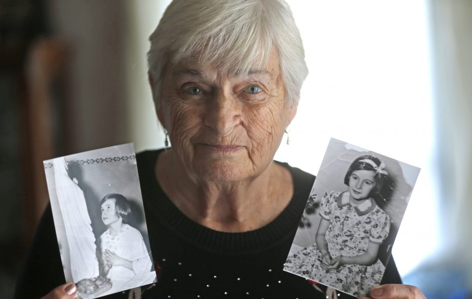 Myrtle Pickering displays photos that traveled to media outlets around the nation, when she wrote a letter as child in a Buffalo orphanage to President Franklin D. Roosevelt.  (Robert Kirkham/Buffalo News)