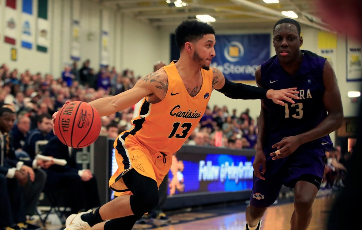 Canisius forward Isaiah Reese dribbles around Niagara's Matt Scott during second half action at the Koessler Center on Saturday, Jan. 27, 2018. (Harry Scull Jr./Buffalo News)