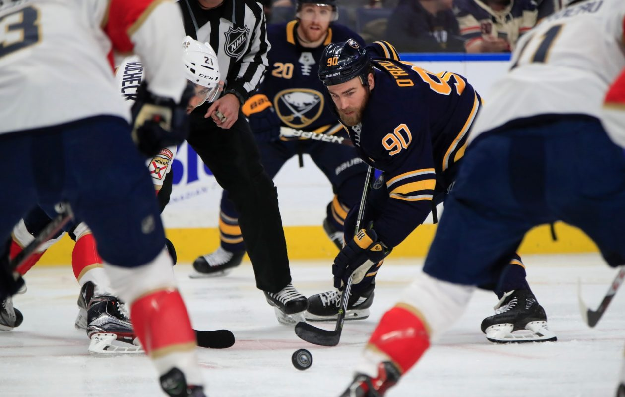 Ryan O'Reilly wins a faceoff against the Florida Panthers during the first period Thursday (Harry Scull Jr../Buffalo News).