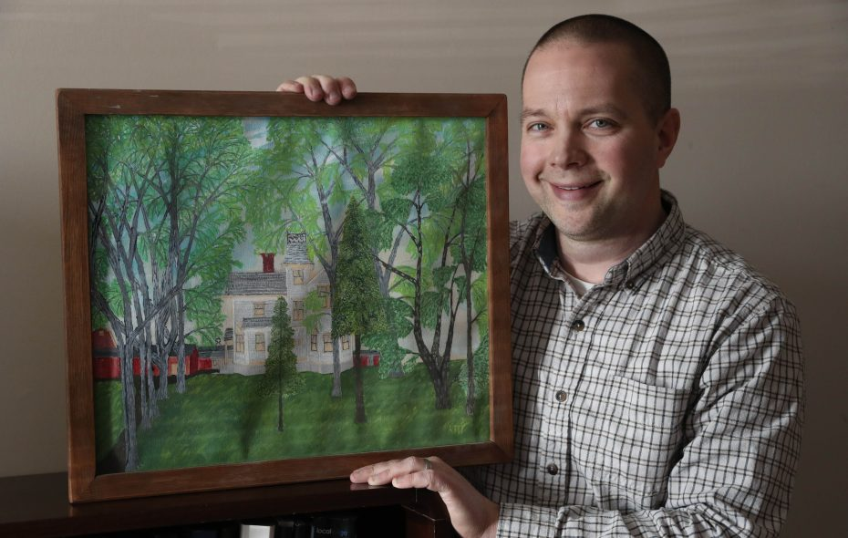 """Bob Confer, president of Confer Plastics in North Tonawanda and a Gasport resident, shows off a painting of his house by Ruthven """"Bud"""" Kill that hangs in his office. Kill did the painting and a similar one of the house when it was owned by Confer's grandmother. Seeing the painting, with many barns and outbuildings that are now gone, brings back great childhood memories for Confer. (Sharon Cantillon/Buffalo News)"""