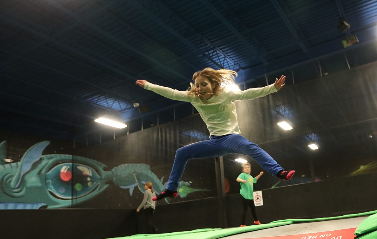 Bella Taggart, 9, jumps off the trampoline into the foam at Get Air Buffalo trampoline park.  (Sharon Cantillon/Buffalo News)