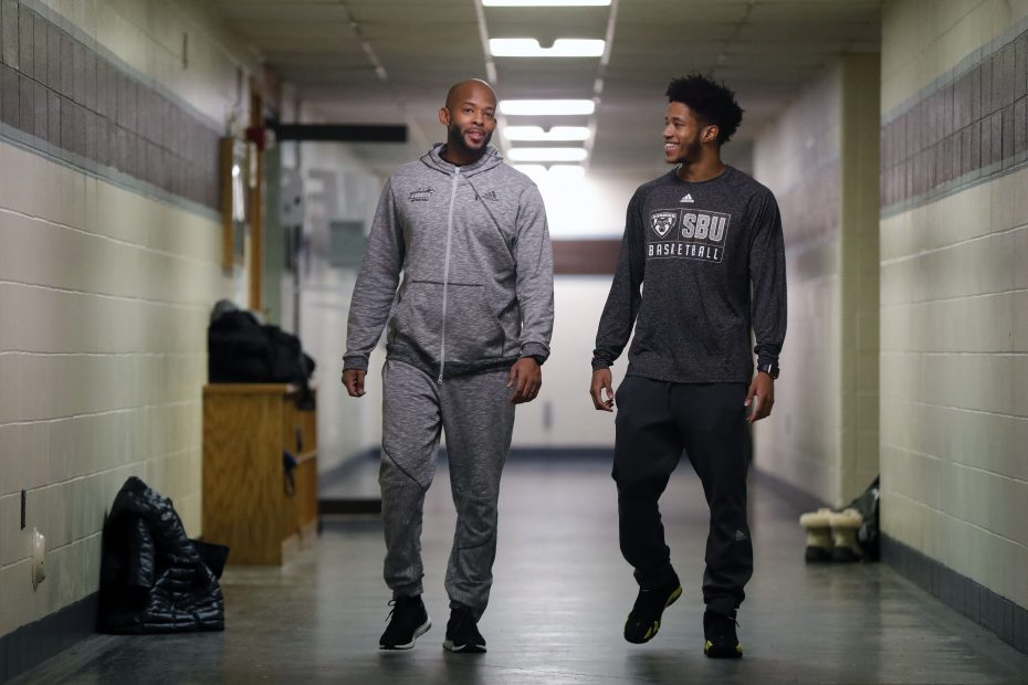 The brotherly bond between St Bonaventure assistant basketball coach Dwayne Lee, left, and Jason strengthened after the loss of their parents.  (Mark Mulville/Buffalo News)