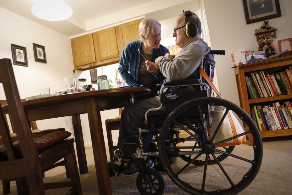 Kris and Paul Scharoun-DeForge: Despite Paul's struggle with dementia, Kris remains deeply committed to him after almost 25 years of marriage. (Derek Gee/Buffalo News)