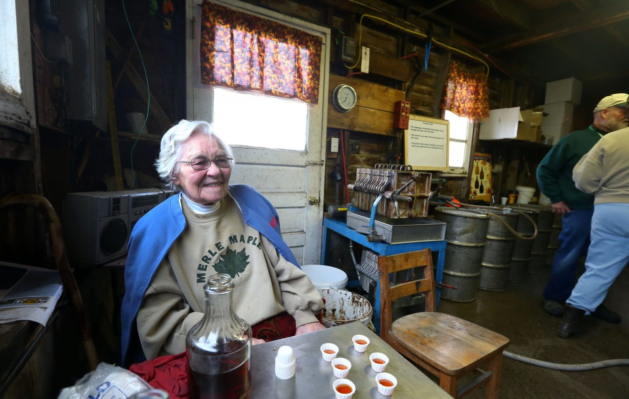 In 2015, Florence Merle - then 'only' 100 - poured shots of maple syrup for visitors to the Merle Maple Farm in Attica. (Mark Mulville/The Buffalo News)