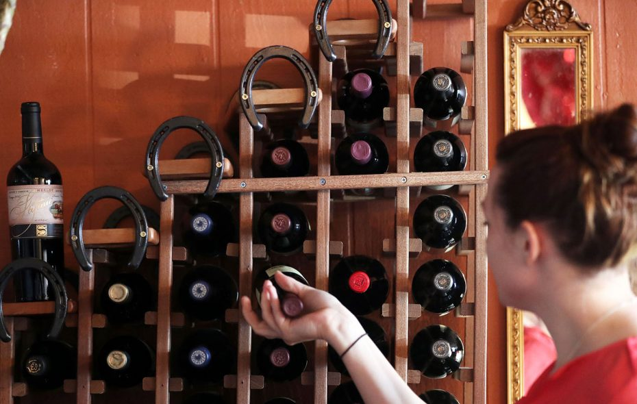 Horseshoes top the wine rack at Mambrino King Wine Coffee and Chocolate Bar, one of the wine bars featured in this guide. (Sharon Cantillon/Buffalo News)