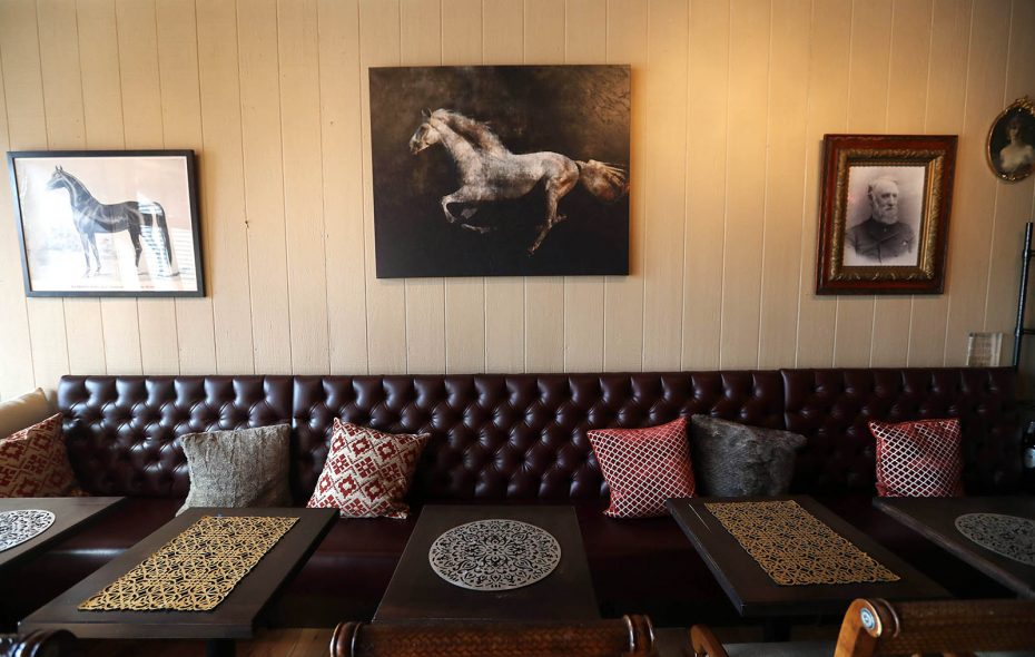 Inside Mambrino King Wine Coffee and Chocolate Bar in East Aurora, the decor pays homage to the race horse of the same name in the 1880s. (Sharon Cantillon/Buffalo News)