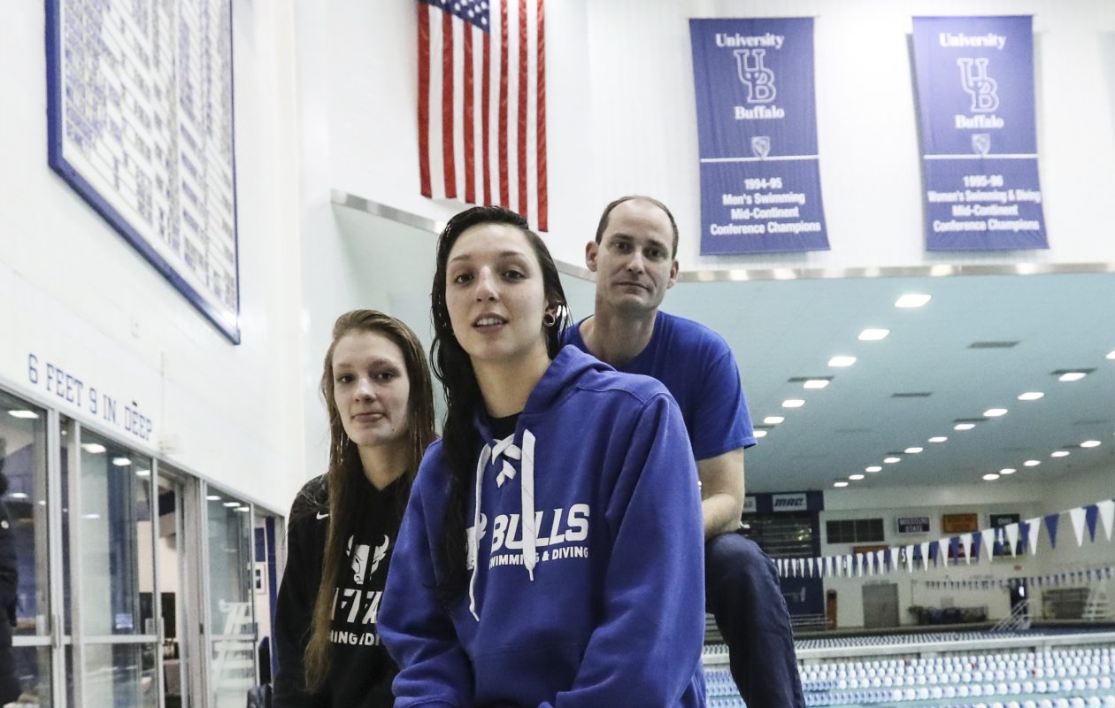 Megan Burns, foreground, Andrea Ernst and coach Andy Bashor are rising to new heights this season. (James P. McCoy / Buffalo News)