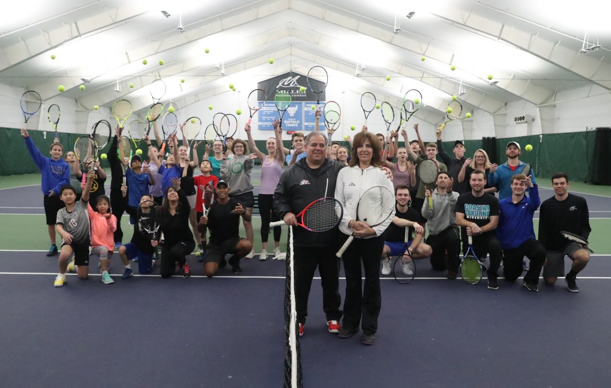 """Todd and Debbie Miller are joined by many of their staff and students at the Miller Tennis Center, which was named the Professional Tennis Registry's 'Private Tennis Facility of the Year Award"""" for 2018. (James P. McCoy / Buffalo News)"""