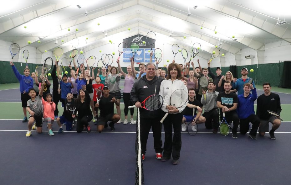 "Todd and Debbie Miller are joined by many of their staff and students at the Miller Tennis Center, which was named the Professional Tennis Registry's ""Private Tennis Facility of the Year Award"" for 2018. (James P. McCoy / Buffalo News)"