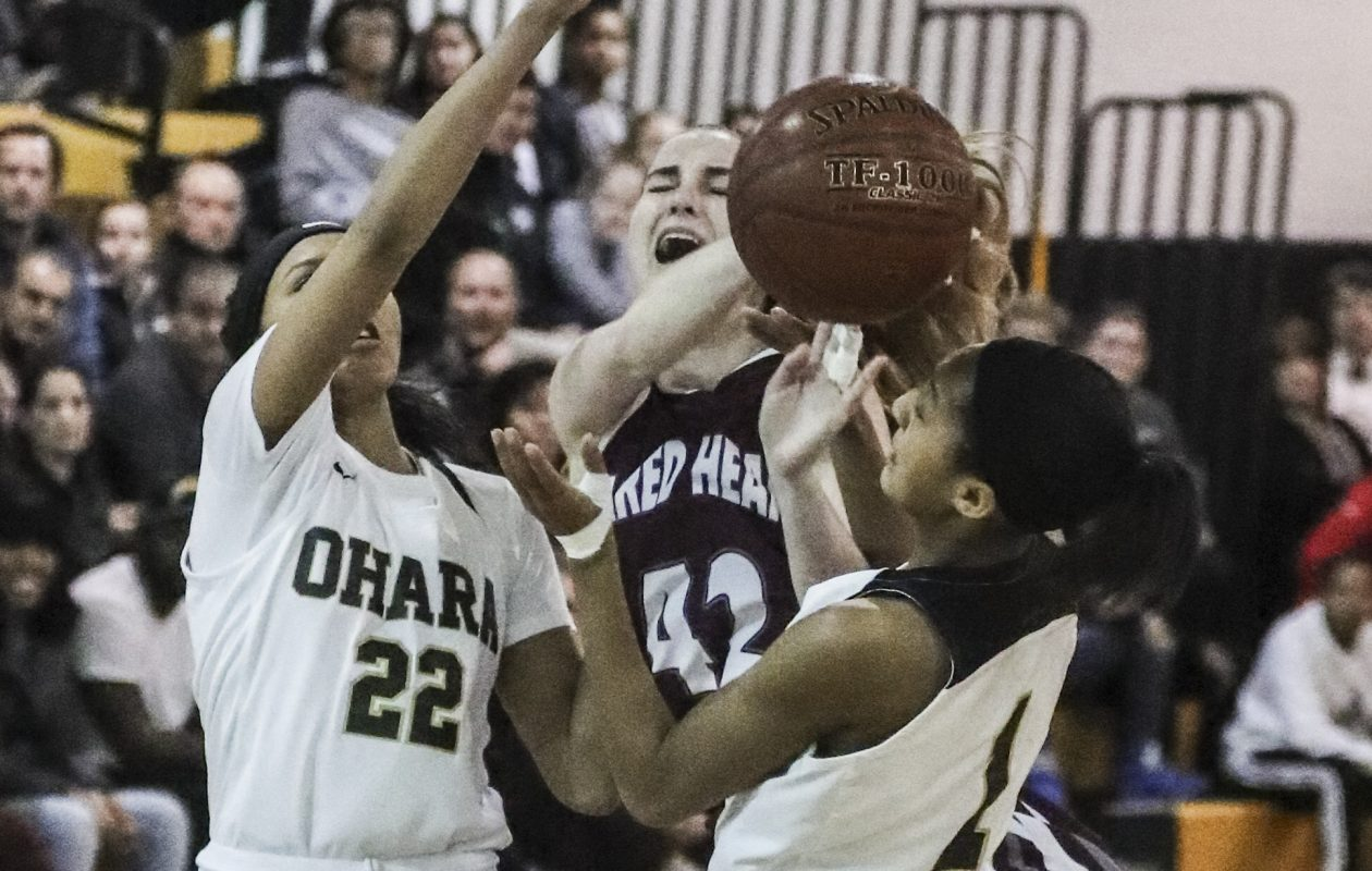 Sacred Heart's Micaela Ryan is guarded by Cardinal O'Hara's Cierra Harrison and Angel Parker in the first half during their game Wednesday (James P. McCoy/Buffalo News)