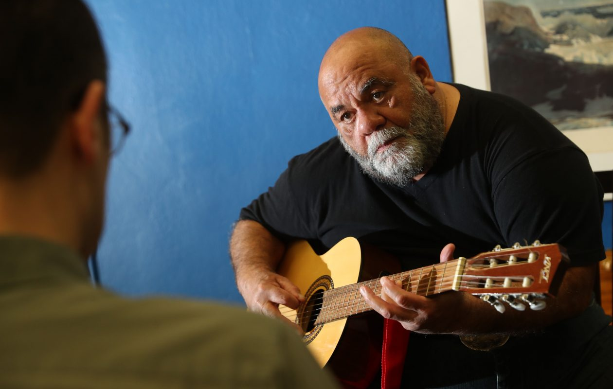 Saturnino Burgos, right, takes guitar lessons from Jason Beaudreau at Niagara Arts and cultural center in Niagara Falls, Tuesday, Feb. 20, 2018.  He received 10 lessons as part of the Senior Wishes program.  (Sharon Cantillon/Buffalo News)