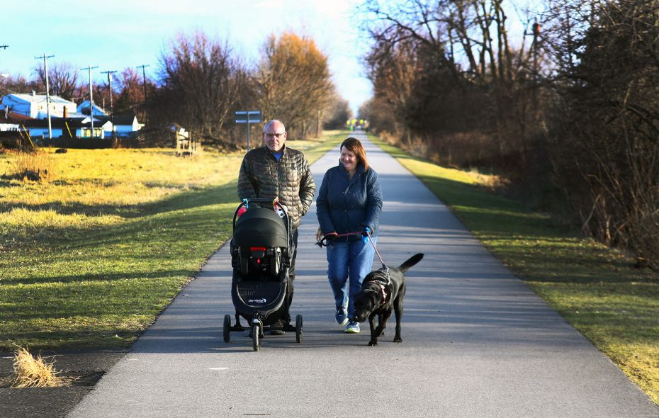 Jim and Doreen Bailey of Eden walk their 6-month-old grandson Carter Bailey and their dog Oakley on the Rails to Trails Bike Path in the Town of Tonawanda on Feb. 24. (John Hickey/Buffalo News)