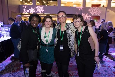 Smiles at WEDI Winterfest in Atrium at Rich's