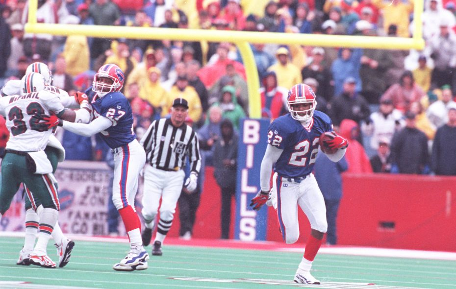 Former Bills cornerback Jeff Burris runs with the ball after intercepting Miami quarterback Craig Erickson to seal a 9-6 victory over the Dolphins on Nov. 2, 1997. (James P. McCoy/Buffalo News file photo)