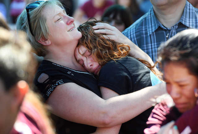 Tonya Kramer embraces her daughter Alyssa Kramer, 16, during a prayer vigil after Wednesday's school shooting in Parkland, Fla. (Matt McClain/Washington Post)