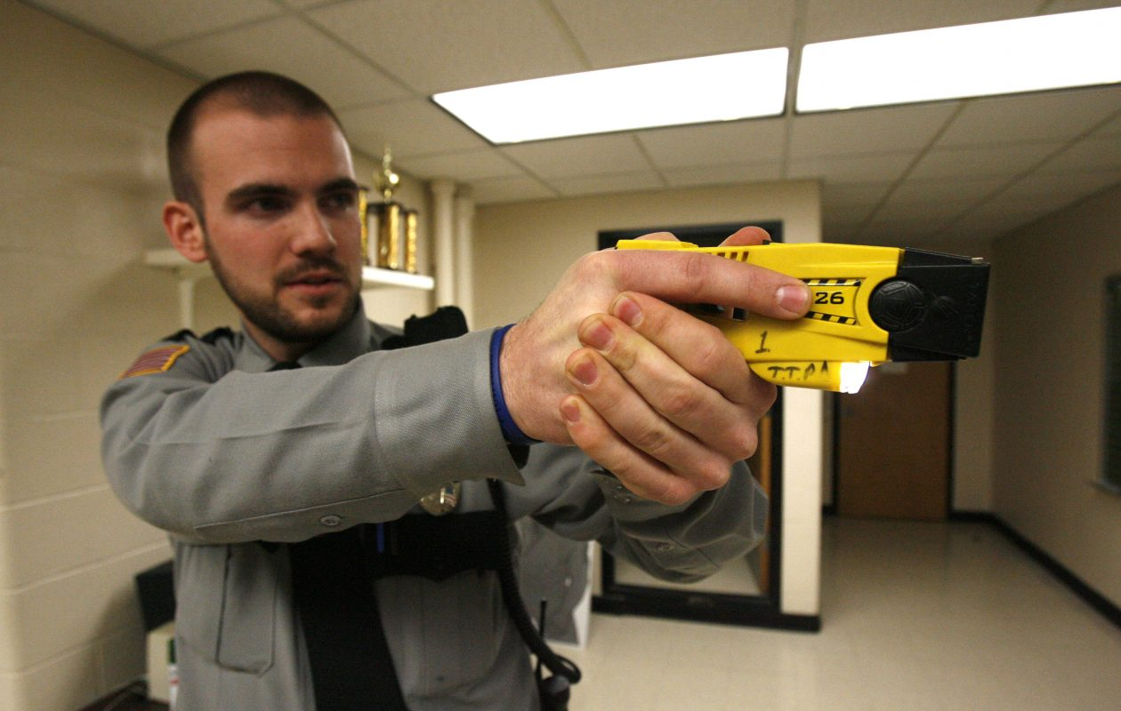 Buffalo Police are considering the use of Tasers, such as this one demonstrated by Town of Tonawanda Police Officer Pat Day. (Robert Kirkham/Buffalo News)