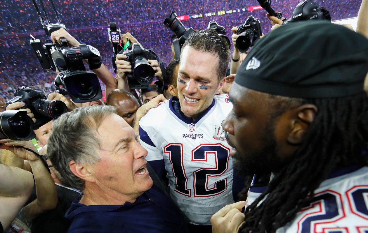 Head coach Bill Belichick, quarterback Tom Brady  and LeGarrette Blount (No. 29) of the New England Patriots celebrate after defeating the Atlanta Falcons during Super Bowl 51 at NRG Stadium on February 5, 2017 in Houston, Texas. The Patriots defeated the Falcons 34-28.  (Getty Images)
