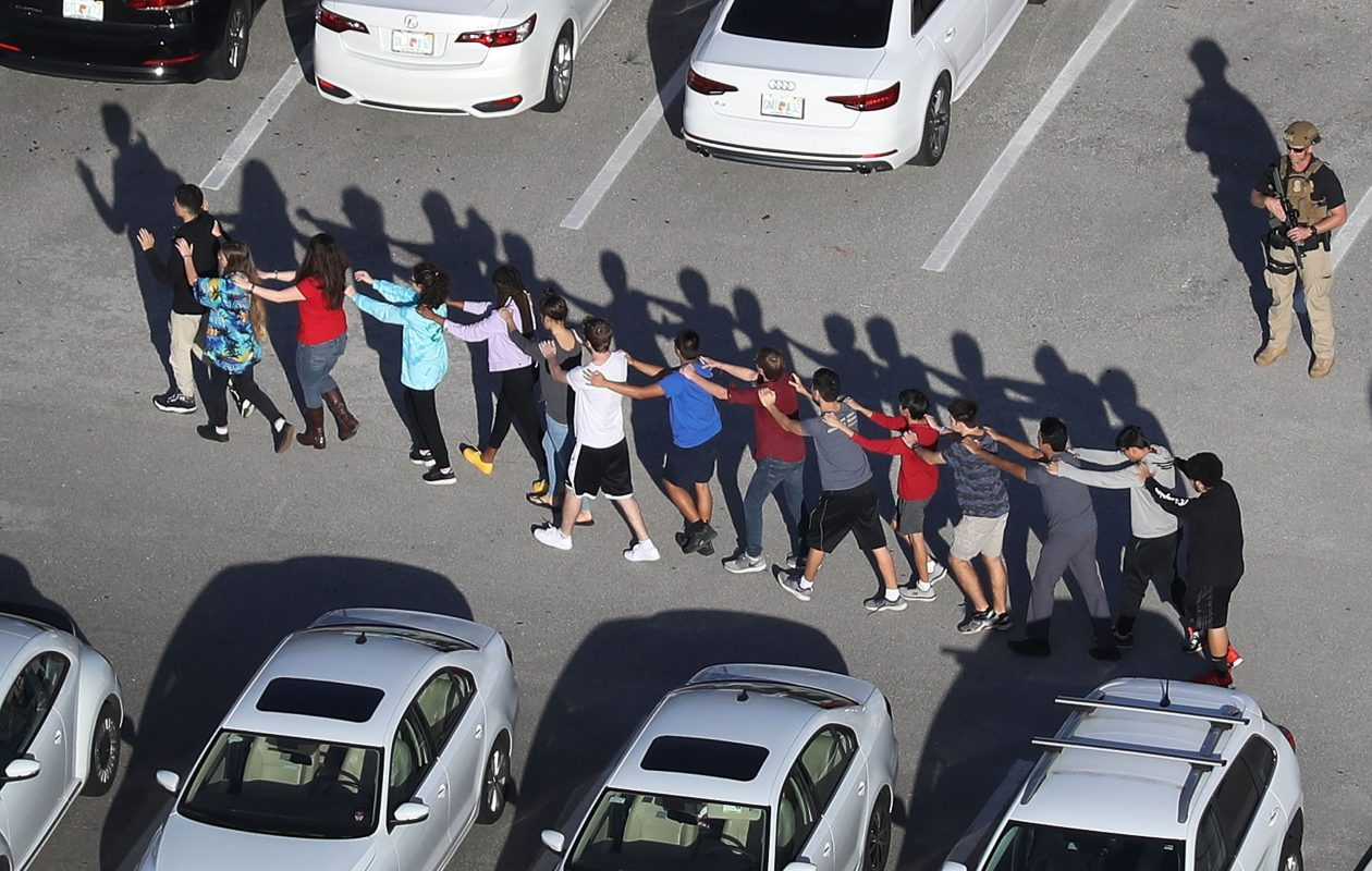 Students are brought out of the Marjory Stoneman Douglas High School after a shooting at the school that killed 17 people and wounded more on Feb. 14. (Getty Images)