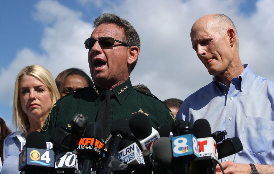 Broward County Sheriff, Scott Israel, center, Florida Governor Rick Scott,(R),and Florida Attorney General Pam Bondi,(L), speak to the media about the mass shooting at Marjory Stoneman Douglas High School where 17 people were killed yesterday, on February 15, 2018 in Parkland, Florida. Police arrested the suspect after a short manhunt, and have identified him as 19 year old former student Nikolas Cruz.  (Photo by Mark Wilson/Getty Images)