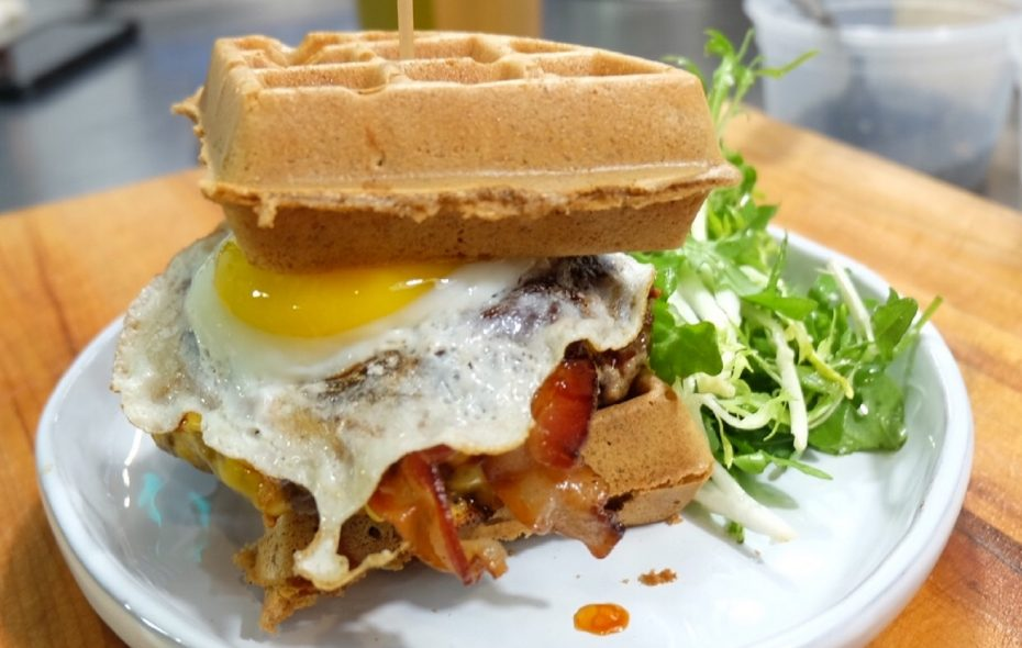 A bacon cheeseburger with a fried egg is one example of a waffle special. (Photo courtesy Black Iron Bystro.)