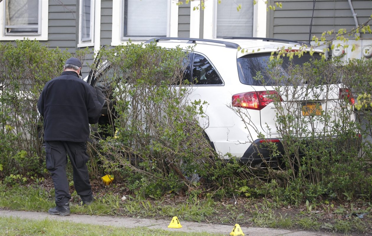 The suspect's SUV landed in the hedges of a nearby home after a traffic stop turned into a struggle and then a fatal shooting on May 7. (Robert Kirkham/Buffalo News file photo)