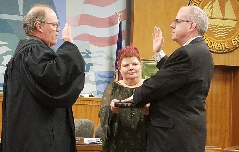 William Reece is sworn in as City of Tonawanda First Ward councilman in February by City Court Judge Mark Saltarelli as Reece's wife, Christina, holds the Bible. The Conservative line for that seat is on the ballot Thursday. (Buffalo News)