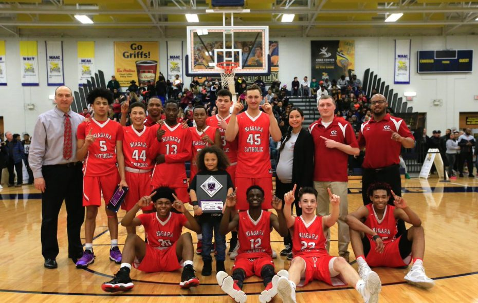 Niagara Catholic shows off the fruits of its labor, the Class B Manhattan Cup after beating Cardinal O'Hara on Tuesday. (Harry Scull Jr./Buffalo News)