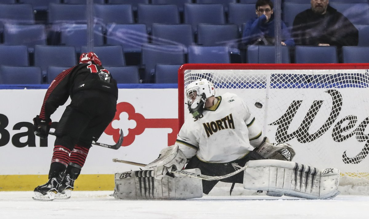 Chace Woods scores on a penalty shot for Niagara Wheatfield during its 2-0 win over Williamsville North in the Section VI Division I hockey final at KeyBank Center (James P. McCoy/Buffalo News)