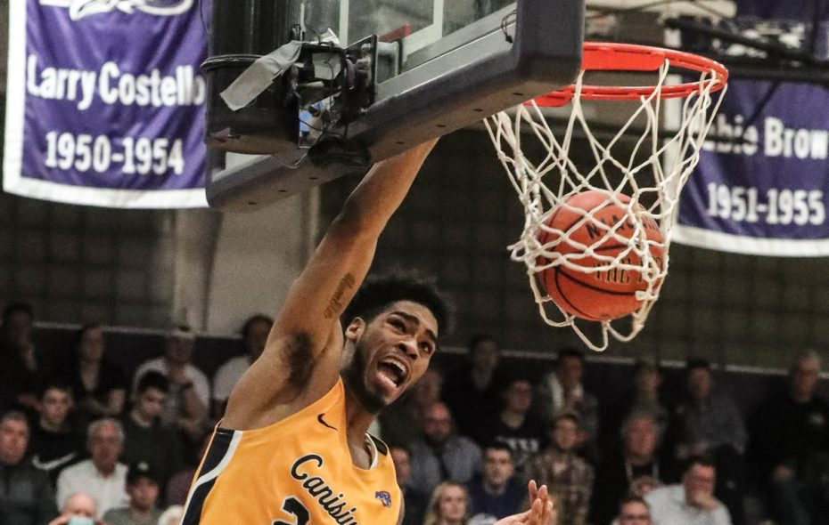 Canisius forward Jibreel Faulkner (22) dunks the ball over Niagara Purple Eagles forward Marvin Prochet (11) in the second half in the Gallagher Center at Niagara University in Lewiston NY on Wednesday, Feb. 21, 2018.  (James P. McCoy / Buffalo News)