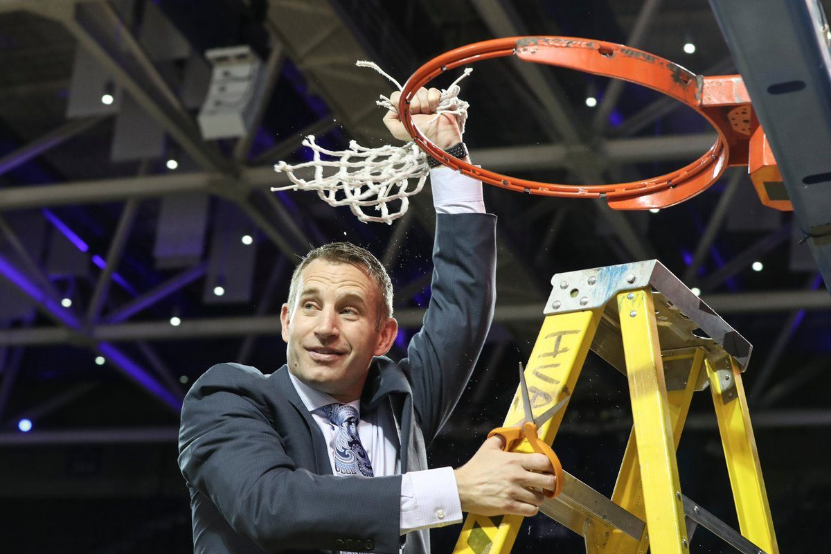 UB coach Nate Oats celebrates the school's first MAC regular-season title in February. (James P. McCoy/Buffalo News)