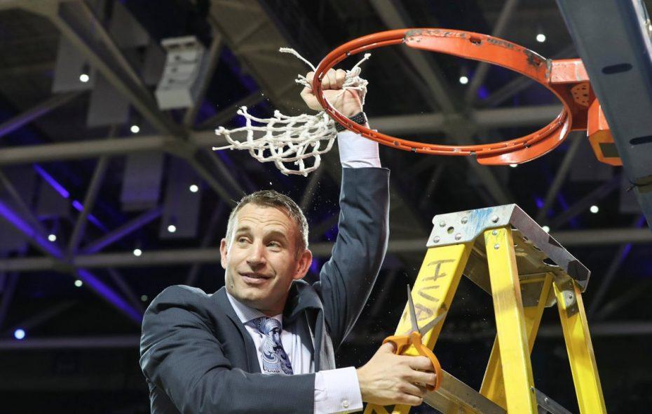 UB coach Nate Oats celebrates the school's first MAC regular-season title in February. (James P. McCoy/News file photo)