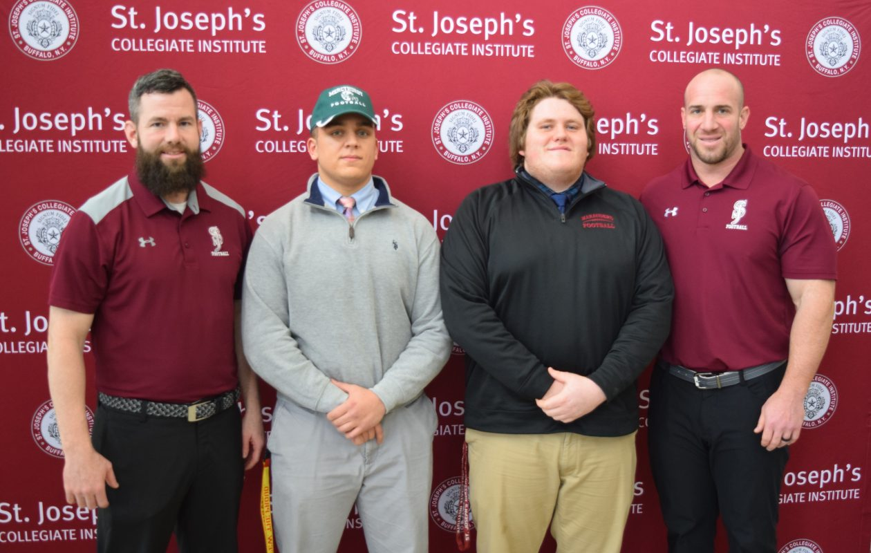 Cam Dabill, second from left, and Andy Gradolph, will attend Division II schools in Erie, Pa.