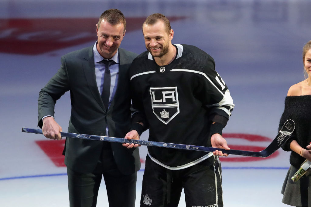 Marian Gaborik gets a silver stick from Los Angeles GM Rob Blake during a December ceremony honoring Gaborik's 1,000th NHL game (Getty Images).