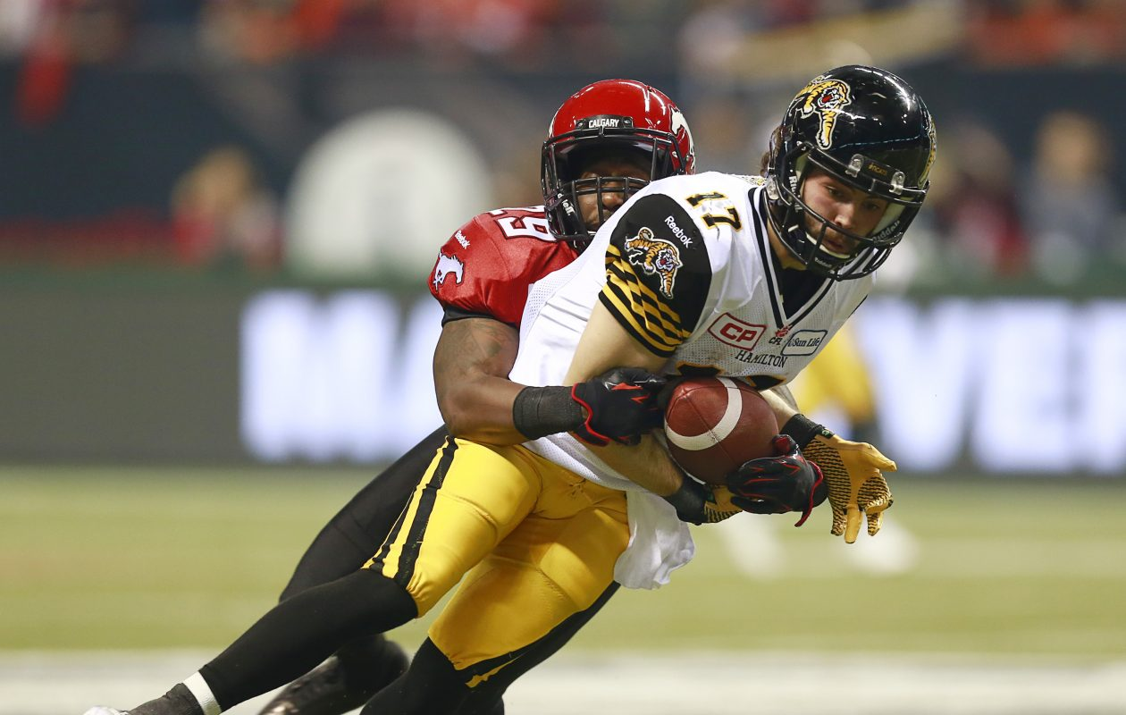 Luke Tasker (17) makes a catch against Calgary's Jamar Wall (29) during the 2014 Grey Cup Game. (Jeff Vinnick/Getty Images)