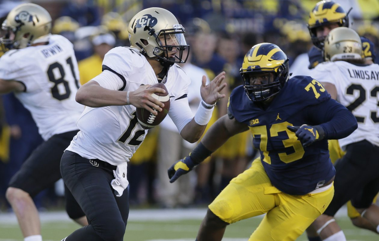 Michigan's Maurice Hurst (73) chases Colorado QB Steven Montez (12) during a game in September 2016 in Ann Arbor, Mich. (Duane Burleson/Getty Images)