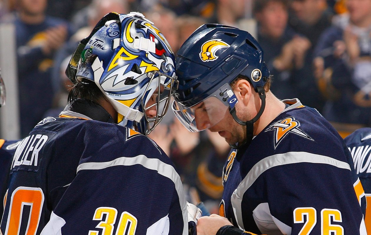 Ryan Miller and Thomas Vanek have memories that aren't as fun as postgame celebrations. (Getty Images)
