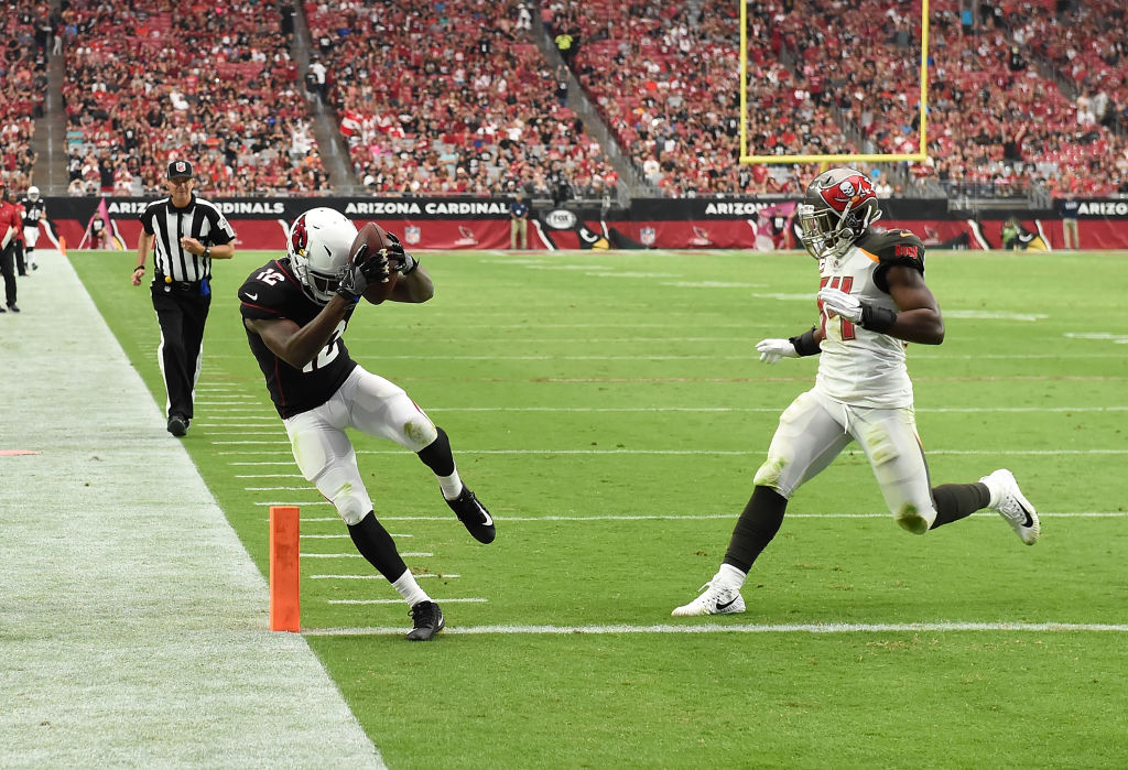 John Brown #12 of the Arizona Cardinals scores a touchdown past Lavonte David #54 of the Tampa Bay Buccaneers during the third quarter at University of Phoenix Stadium on October 15, 2017 in Glendale, Arizona. Cardinals won 38-33. (Photo by Norm Hall/Getty Images)