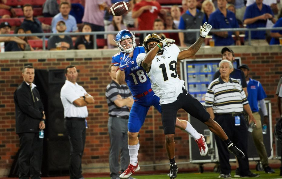 Mike Hughes tips the ball away from Trey Quinn of SMU (Cooper Neill/Getty Images)