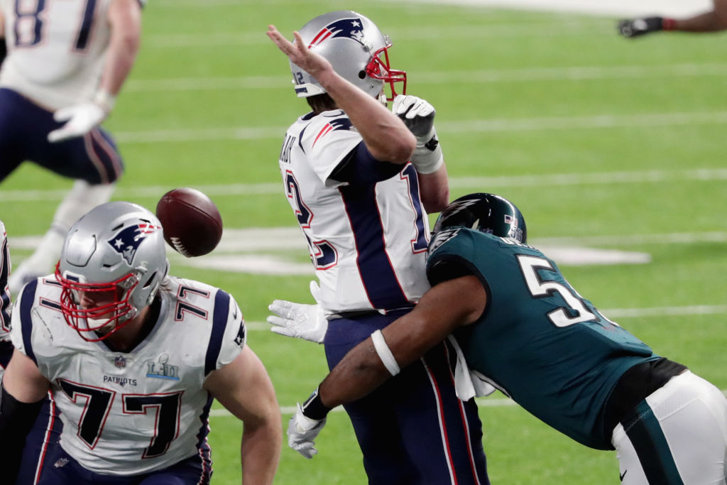 Tom Brady has the ball stripped by Brandon Graham of the Philadelphia Eagles late in the fourth quarter in Super Bowl LII. (Getty Images)