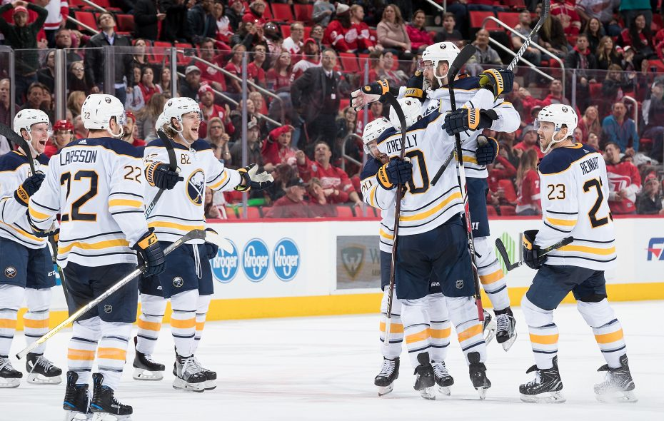 The Sabres rush to celebrate the winning goal by Marco Scandella (6) with only 0.2 seconds left in overtime. (NHLI via Getty Images)