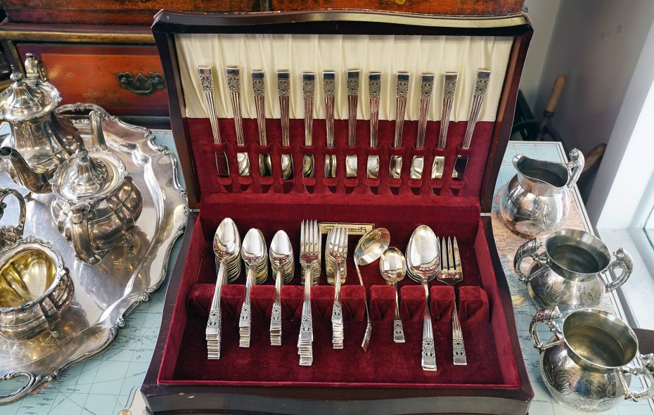 """""""This is where the antique dealers go to sell their gold and silver, tea sets, silverware, coins and designer jewelry,"""" said Louise Simon Schoene, a West Seneca art and jewelry collector of Grand Gold & Silver Buyers in Amherst. (Dave Jarosz)"""