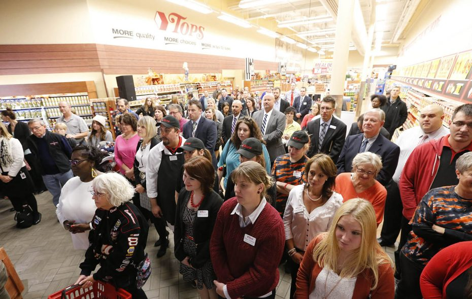 Employees, vendors and customers are among the crowd during the grand re-opening ceremony at the Tops on Grant Street, Wednesday, Oct. 8, 2014.  Union workers are closely watching the company's reorganizational bankruptcy filing. (Derek Gee/News file photo)