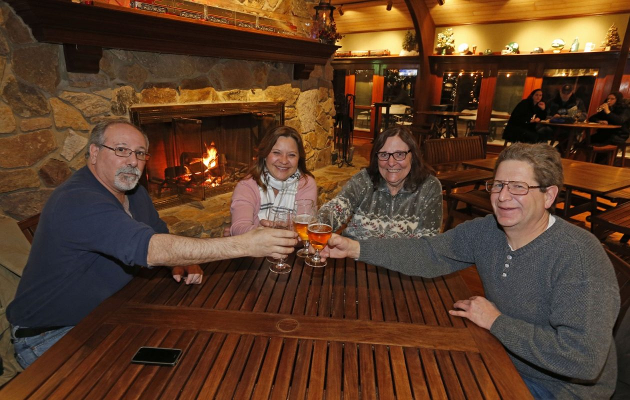 From left, Angelo Caruana and Debbie Weiler of Boston, NY, enjoy good stories and fresh beers with companions Valerie and Randy Ryan of Hamburg.   (Robert Kirkham/Buffalo News)