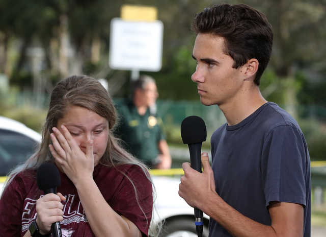 Students Kelsey Friend (L) and David Hogg recount their stories about last week's mass shooting at the Marjory Stoneman Douglas High School in Parkland, Fla. (Mark Wilson/Getty Images)