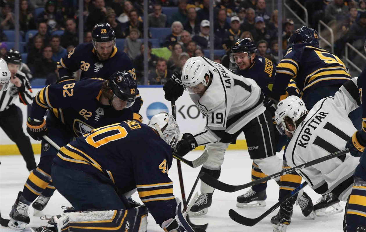 Eden's Alex Iafallo (19) helped make it another early exit for Sabres goalie Robin Lehner. (James P. McCoy/Buffalo News)