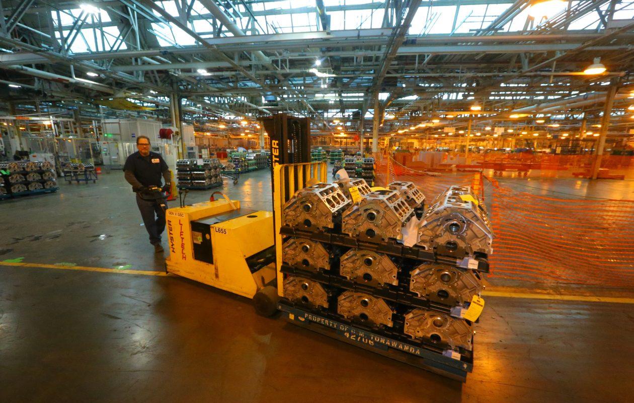 A GM worker moves engines at GM's Tonawanda engine plant.  (John Hickey/News file photo)